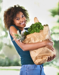 woman with bag of foods that are good for teeth she learned from the family dentist mt holly residents trust