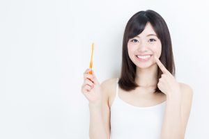 woman with toothbrush and beautiful smile