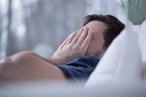 man drowsy from poor sleep