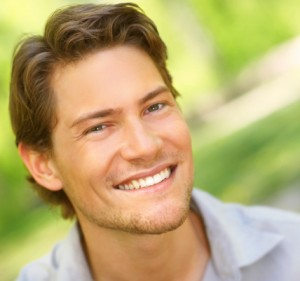 man with a great smile after he stopped smoking and whitened teeth