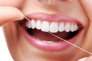 Daily flossing wards off decay and gum disease. Learn reasons behind this oral hygiene habit and how to best do it from your Mt. Holly dentists.