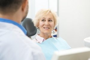woman learns how to maximize dental insurance benefits